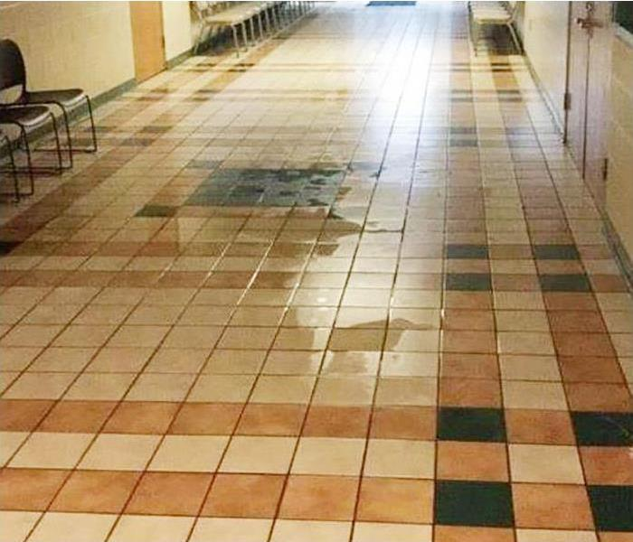 water covering tile floor in commercial property