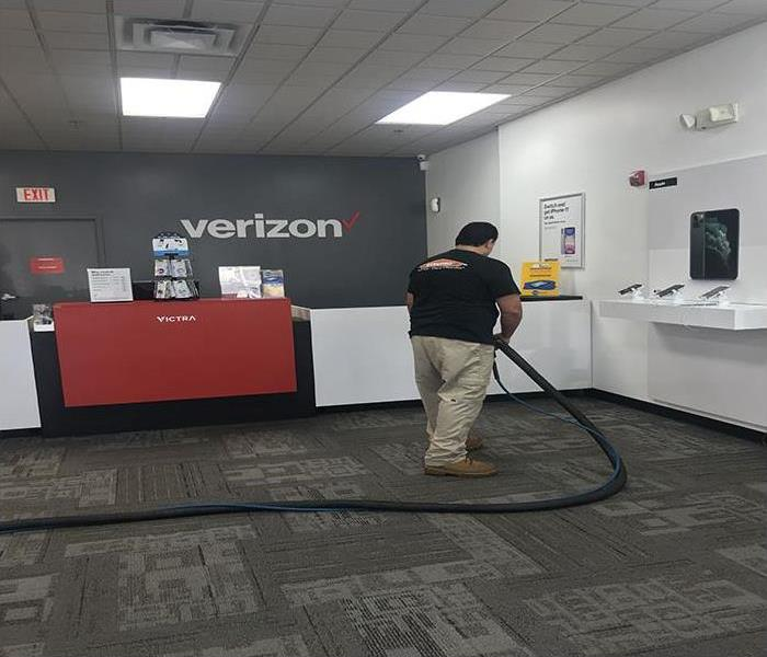 technician cleaning a commercial property after a storm