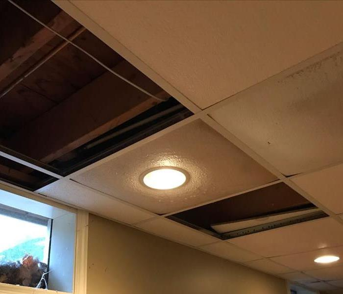 Ceiling tiles removed in an office.